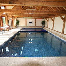 Traditional Pool by Tanby Swimming Pools