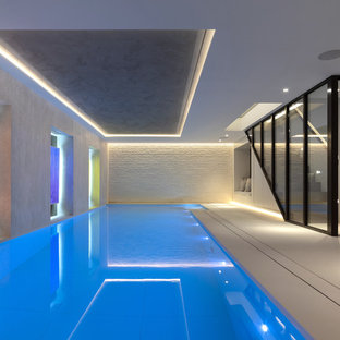 Design ideas for a contemporary indoor rectangular lengths swimming pool in London.