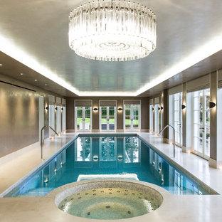 Ejemplo de piscinas y jacuzzis alargados, clásicos renovados, grandes, interiores y rectangulares