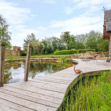 Magical, natural swimming pond with cosy pool house