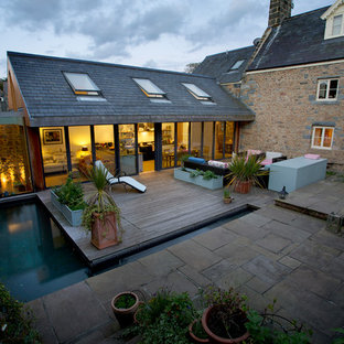 Design ideas for a contemporary back swimming pool in Channel Islands with decking.