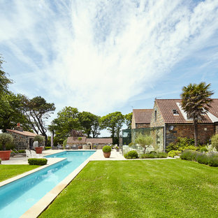 Inspiration for a country rectangular lengths swimming pool in Channel Islands.