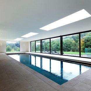 Diseño de piscina tradicional renovada rectangular y interior