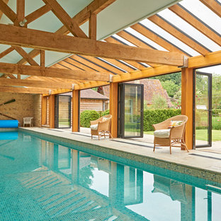 Design ideas for a rural indoor rectangular swimming pool in Gloucestershire.
