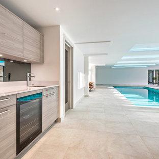 Imagen de piscina alargada, tradicional renovada, interior y rectangular