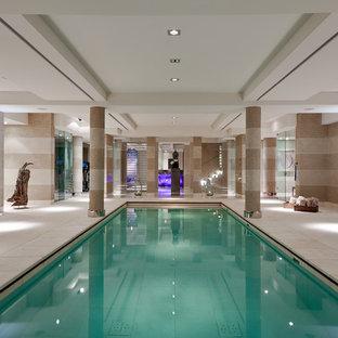 Idee per una grande piscina coperta monocorsia design rettangolare