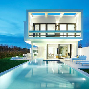 Design ideas for a contemporary back rectangular lengths swimming pool in Other.