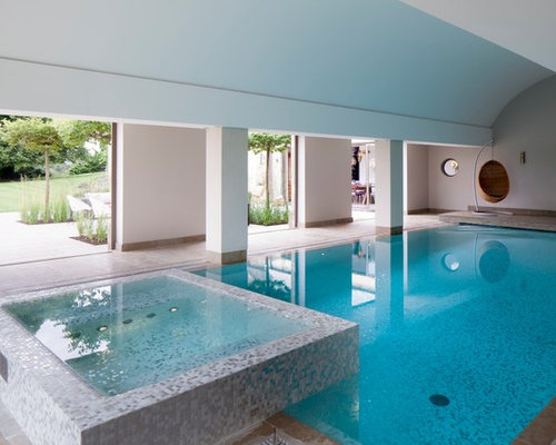 example of a classic indoor rectangular pool design in gloucestershire with a hot tub - Indoor Swimming Pool Design