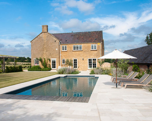 Medium Sized Farmhouse Back Rectangular Swimming Pool In Gloucestershire  With Concrete Slabs.