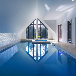 Contemporary indoor rectangular lengths swimming pool in Other with a hot tub and tiled flooring.