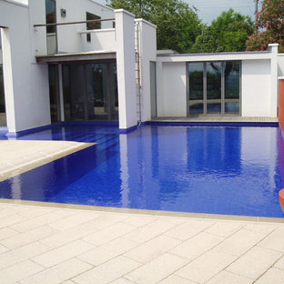 Inspiration for a mid-sized country backyard l-shaped natural pool in Sussex with concrete pavers.