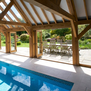 Photo of an expansive farmhouse indoor swimming pool in West Midlands with a pool house.