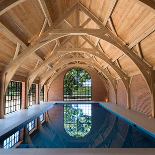 Design ideas for a large traditional indoor rectangular swimming pool in Oxfordshire with tiled flooring.