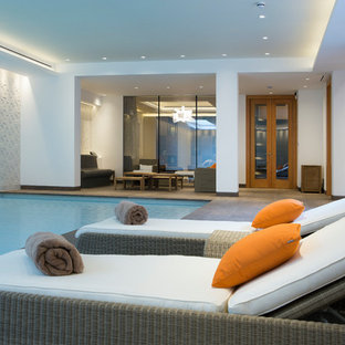 Design ideas for a large contemporary indoor rectangular swimming pool in London with tiled flooring.