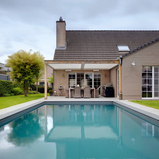 Design ideas for a traditional back swimming pool in Buckinghamshire.