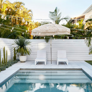 Beach style rectangular pool in Other.