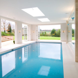Photo of a contemporary indoor rectangular swimming pool in Cheshire.