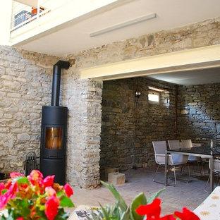 Foto de sótano con ventanas contemporáneo, grande, con estufa de leña, marco de chimenea de madera y suelo multicolor