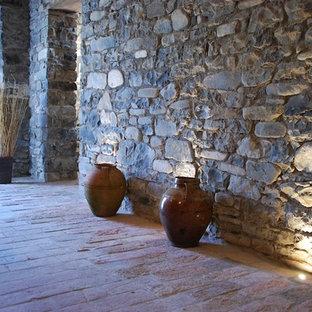 Idée de décoration pour un grand sous-sol design semi-enterré avec un poêle à bois, un manteau de cheminée en bois et un sol multicolore.