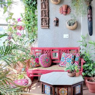 Foto di un balcone eclettico con un giardino in vaso