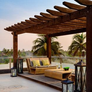 Imagen de terraza tropical con pérgola
