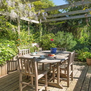 Inspiration for a medium sized farmhouse side terrace and balcony in Devon with a pergola.