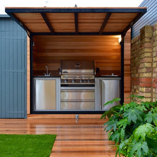 This is an example of a medium sized contemporary back terrace and balcony in London.