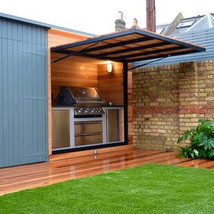 Idee per una terrazza minimal di medie dimensioni e dietro casa