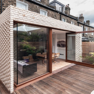 Inspiration for a medium sized contemporary back terrace and balcony in London with no cover.