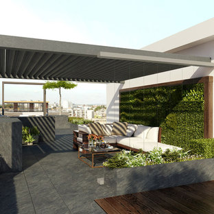 Modelo de terraza contemporánea, pequeña, en azotea, con jardín vertical y pérgola