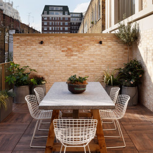Photo of a traditional terrace in London with no cover.