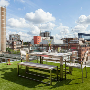 Inspiration for a mid-sized contemporary rooftop deck remodel in London with no cover