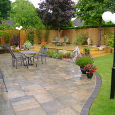 Traditional Deck by Cooks Landscapes