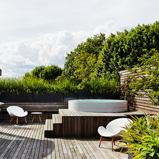 This is an example of a contemporary back terrace in London with no cover.