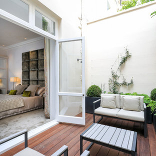 Contemporary side terrace and balcony in London with no cover.