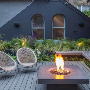 Photo of a small contemporary terrace and balcony in Hampshire with a fire feature.