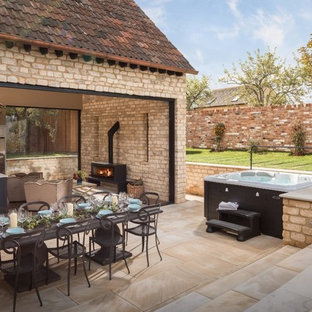Medium sized country side terrace and balcony in Gloucestershire with no cover.