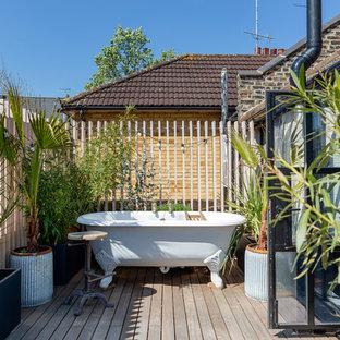 Idee per una terrazza industriale sul tetto con un giardino in vaso e nessuna copertura