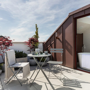 Inspiration for a large contemporary roof terrace and balcony in London with no cover.