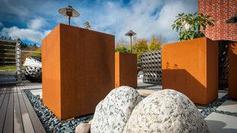 Kinley CorTen planters and Terrafina composite decking
