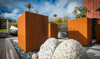 Kinley CorTen planters and Terrafina composite decking