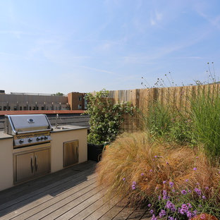 Photo of a medium sized contemporary roof terrace in London with an outdoor kitchen and no cover.