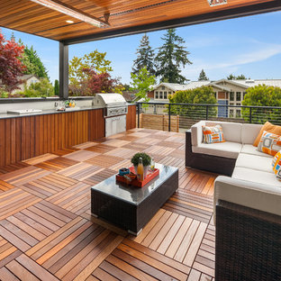 Outdoor kitchen deck - huge 1950s outdoor kitchen deck idea in Seattle with a roof extension