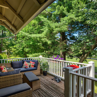 Traditional deck in Boston with an awning.