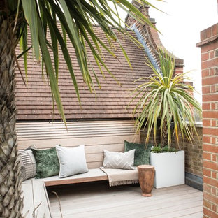 Inspiration for a medium sized contemporary roof terrace and balcony in London with no cover and a potted garden.