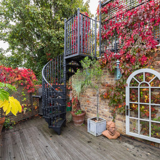 Design ideas for a medium sized bohemian terrace and balcony in London with a potted garden and no cover.