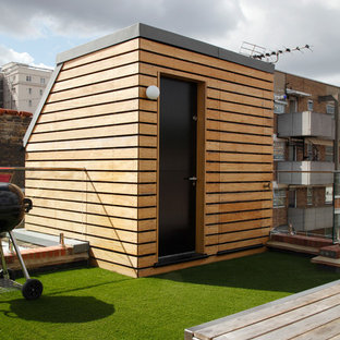 Deck - large contemporary rooftop privacy deck idea in London with no cover