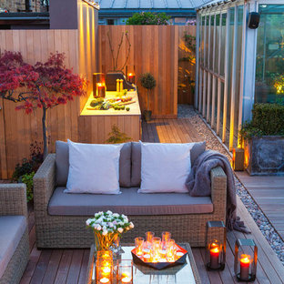 This is an example of a contemporary roof terrace and balcony in London with an outdoor kitchen.