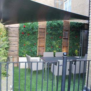 Roof Terrace Sevenoaks - Artificial grass, shade sail, green walls and lighting
