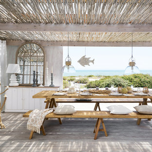 Design ideas for a nautical terrace and balcony in London with a pergola.